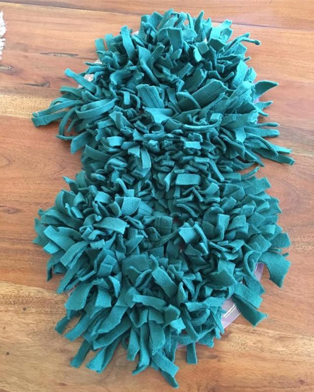 Snuffle mat made by a TNR volunteer to entertain a dog with leg fracture