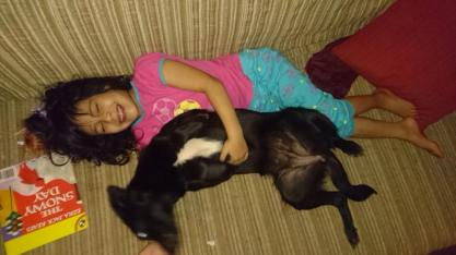 Cora being cuddled by her new friend!