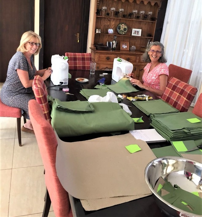 Our talented volunteers Jo and Amanda making surgical drapes