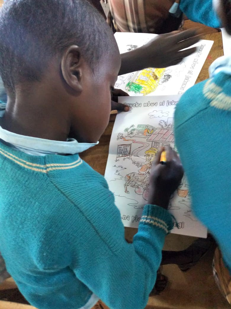 Community Outreach: learning and colouring at Ewaso PrimarySchool